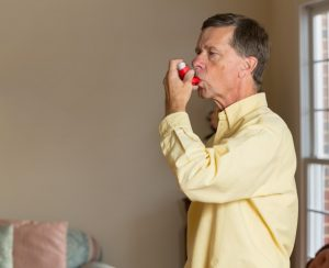 Adult using inhaler