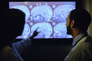 Doctors examining images of the brain